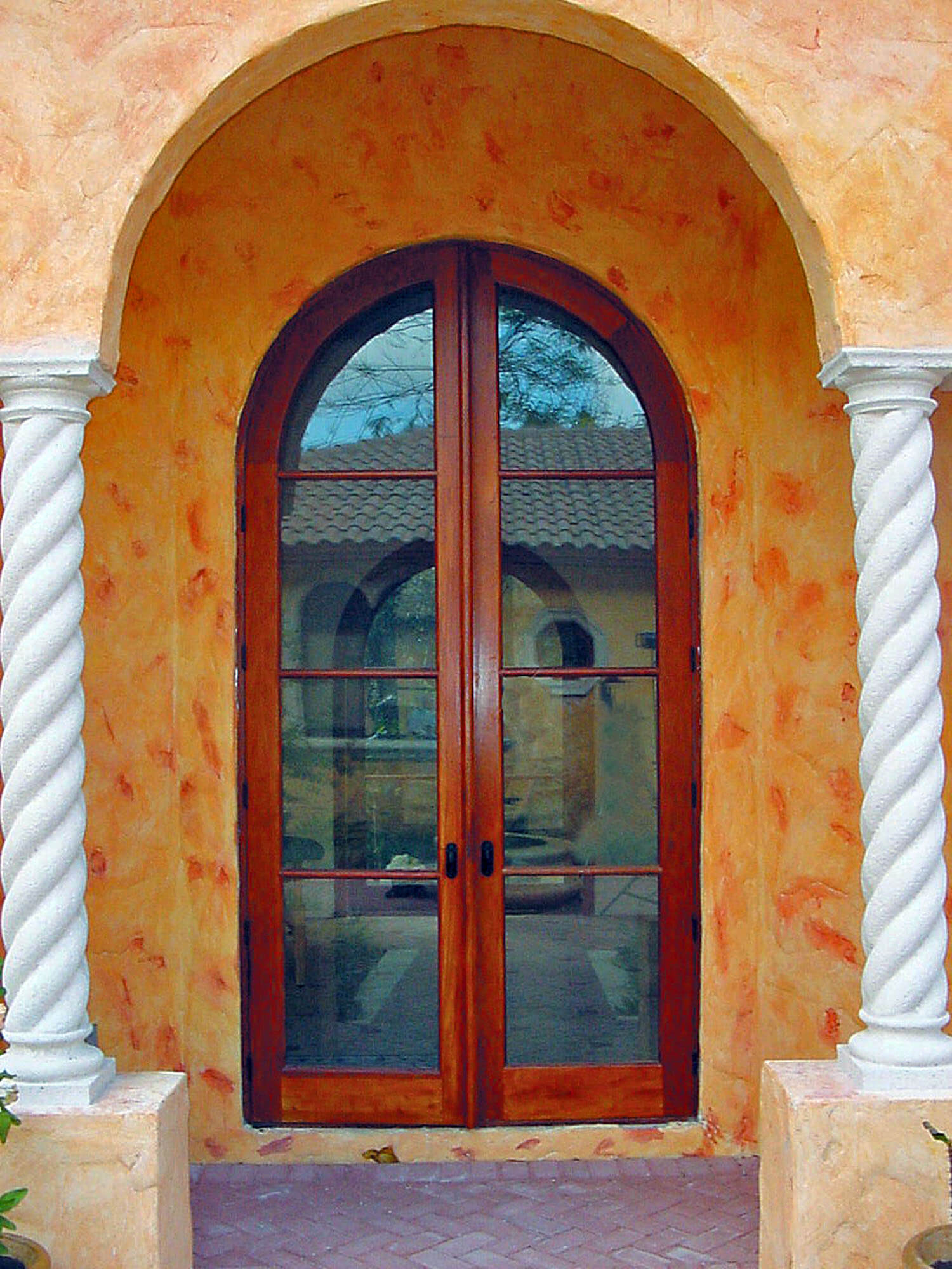 NEW MEXICO MAHOGANY PATIO ARCHED DOOR.