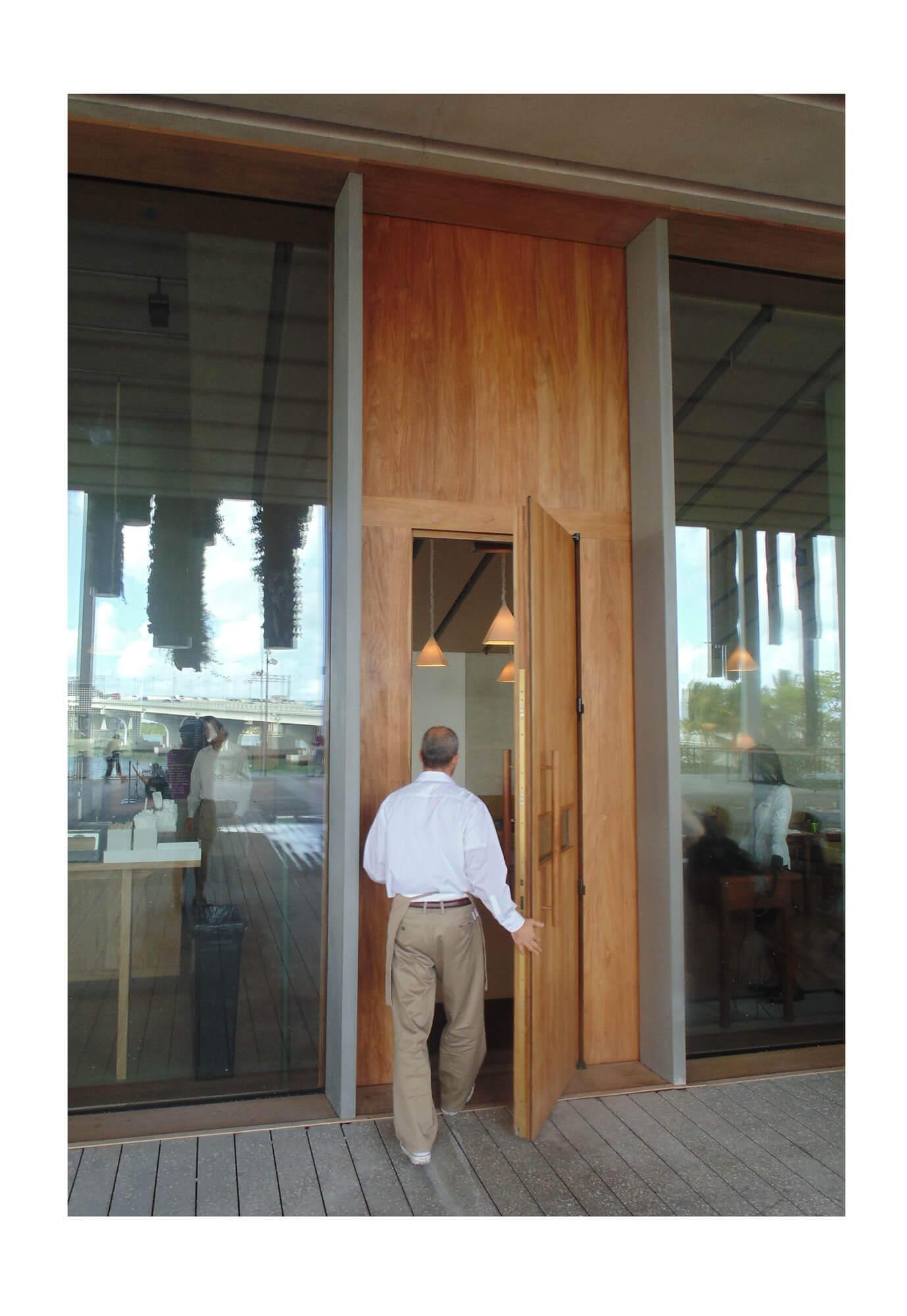 TEAK ENTRY DOOR TO RESTAURANT OF THE MIAMI PEREZ ART MUSEUM.